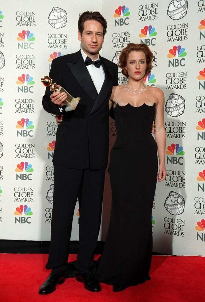 The X-Files stars David Duchovny and Gillian Anderson at the Golden Globe Awards where their show won Best TV Drama Series Featureflash / Shutterstock.com