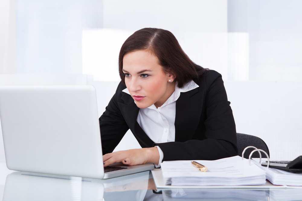 crouching over tech