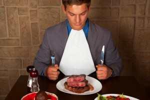 man eating meat