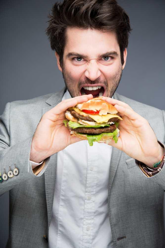men eating meat