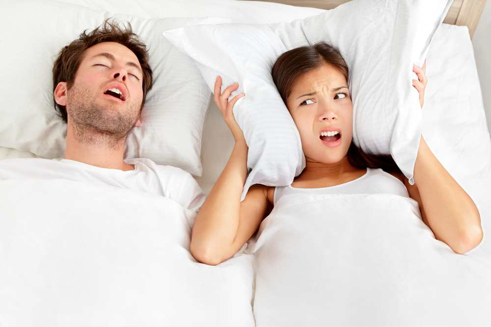Is your partner's snoring keeping you awake? Here's how to solve it TheFuss.co.uk