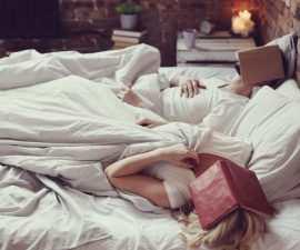 Reading In Bed Shutterstock 384166615